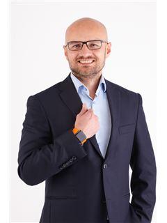 Norbert Dydyński - RE/MAX Invest